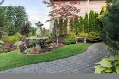 House Manicured Frontyard with Water Fountain